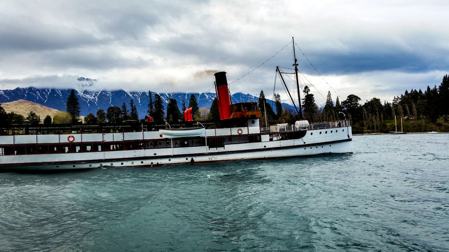 TSS Earnslaw, Queenstown, NZ Earnslaw TSS Earnslaw Architecture Building Exterior Built Structure Cloud - Sky Day Mode Of Transportation Mountain Nature Nautical Vessel No People Outdoors Passenger Craft Sailboat Scenics - Nature Sea Sky Steam Ship Steamship Transportation Travel Tree Water Waterfront