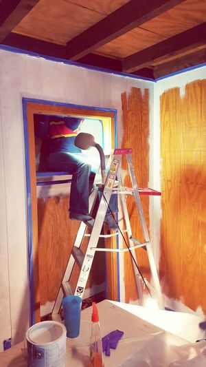 DIY project bedroom makeover. Painting inside the closet. Renovation Do It Yourself Painting Woman Painting Closet Real People Projects Priming Bedroom Home i Home Interior improvement Beautification Old House Paint Brush