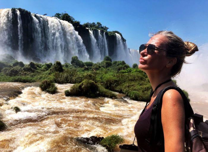 Woman standing by iguacu falls