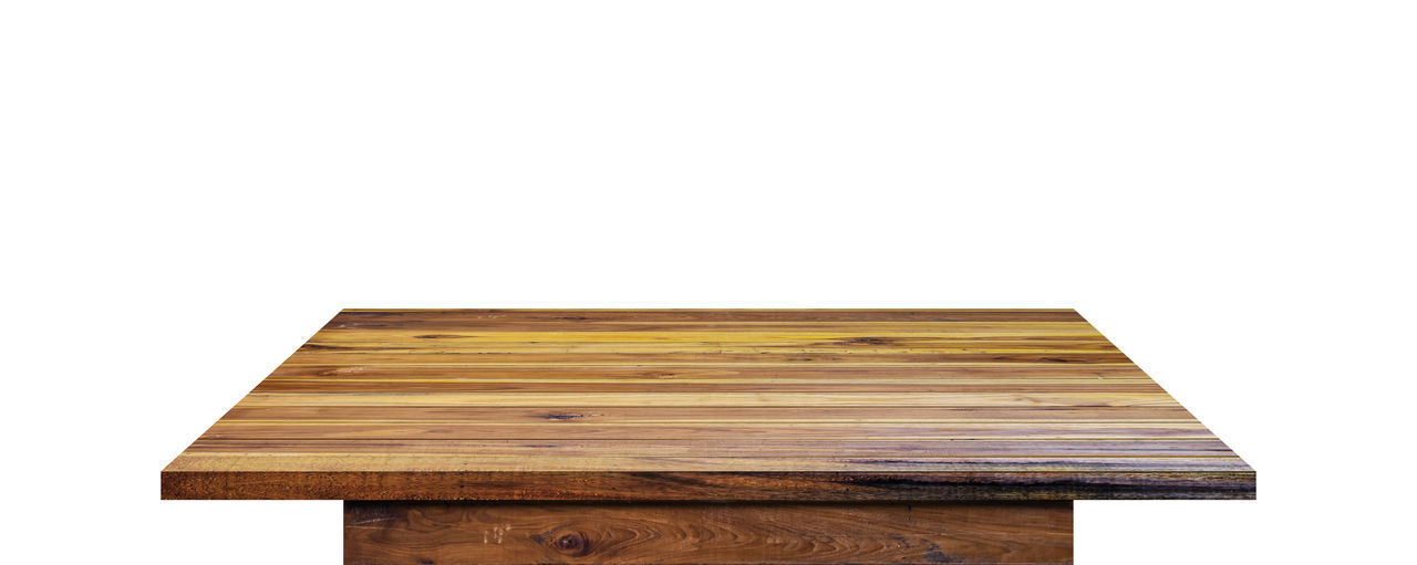 Close-up of wooden table against white background
