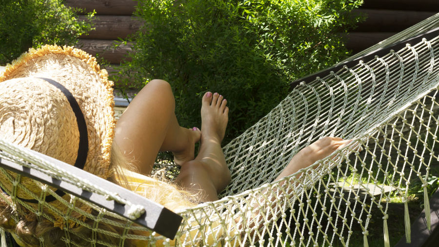 Low section of woman relaxing outdoors