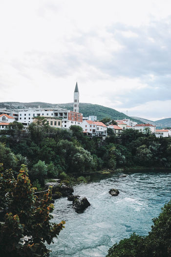 BIH Bosnia And Herzegovina Mostar Architecture Beauty In Nature Bell Tower Bosnia Building Exterior Built Structure City Cityscape Cloud - Sky Day Nature No People Outdoors Place Of Worship Religion River Sky Tree Water