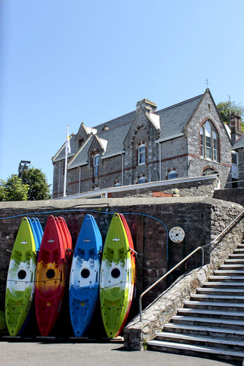 surf boards at the english riviera in Cornwall, UK Architecture Blue Boards Cornwall Uk Day English Riiveria Enjoying Life Façade Fun Multi Colored No People Outdoors Riviera Sea Sky Sport Stairs Summer Surf Surfing Travel Destinations Ukraine