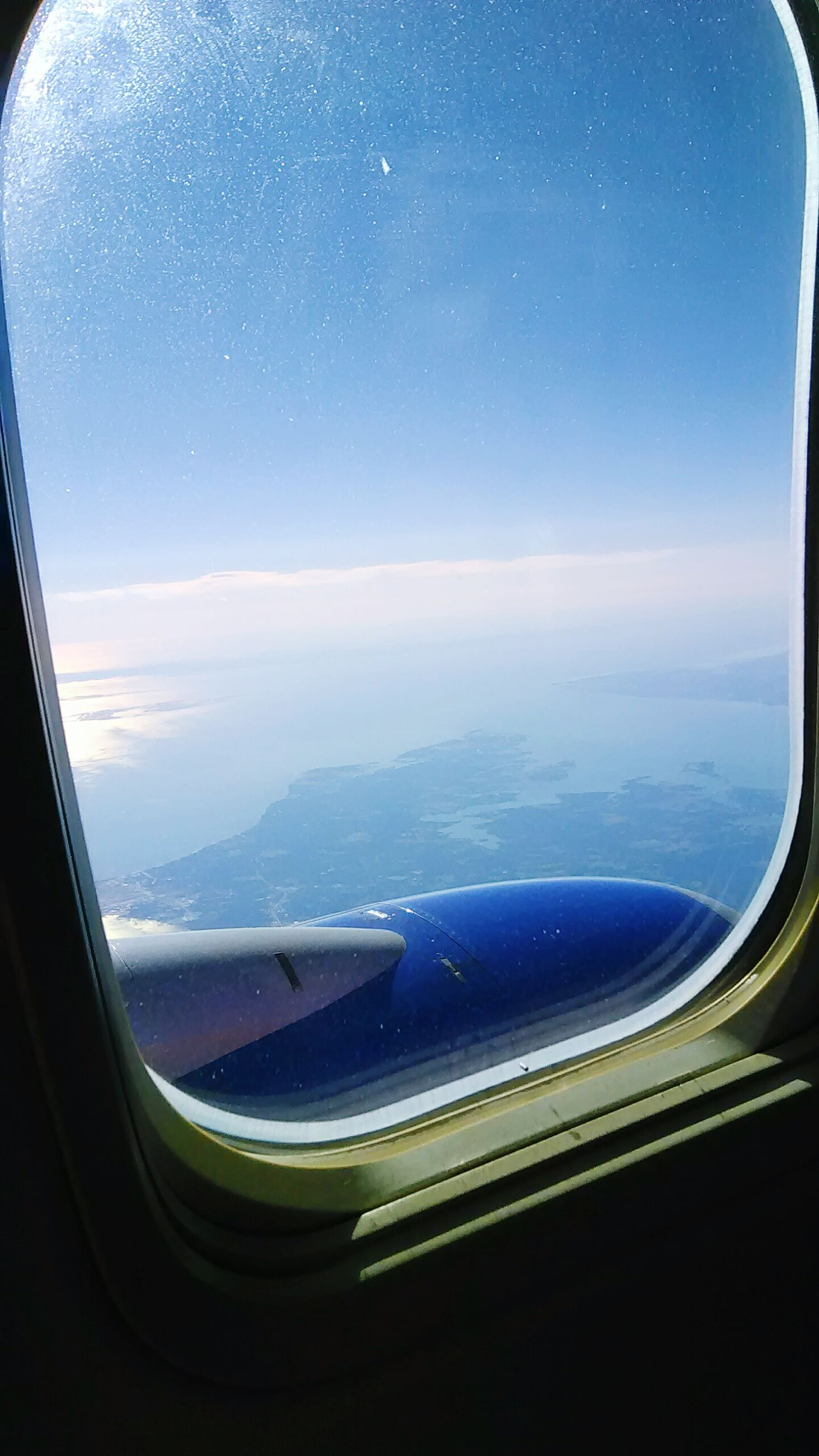 transportation, mode of transport, airplane, air vehicle, vehicle interior, aerial view, aircraft wing, sky, window, travel, on the move, journey, flying, scenics, glass - material, part of, transparent, public transportation, water, sea