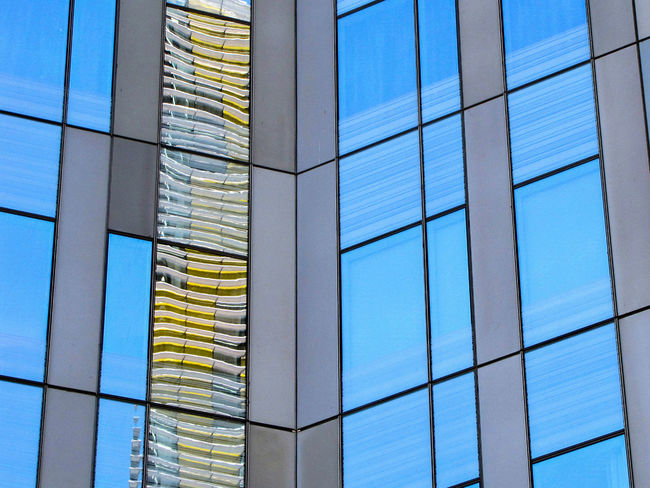 Architecture Blue Building Building Exterior Built Structure City Clear Sky Day Geometric Shape Glass Modern No People Office Office Building Exterior Outdoors Pattern Reflection Sky Skyscraper Window Visual Creativity