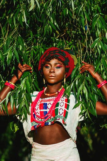 Portrait of model standing against plants