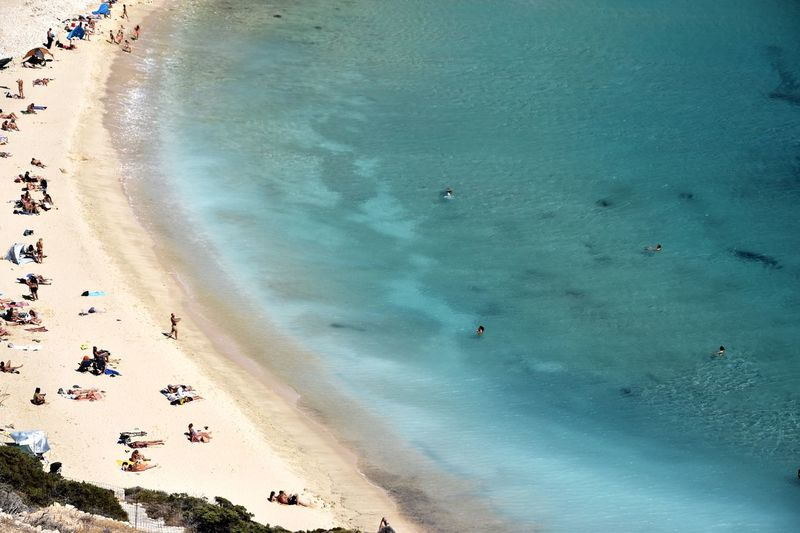 Aerial view of people enjoying at kedros beach