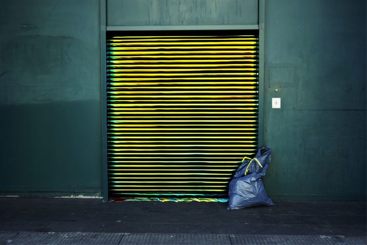 Garbage against closed shutter