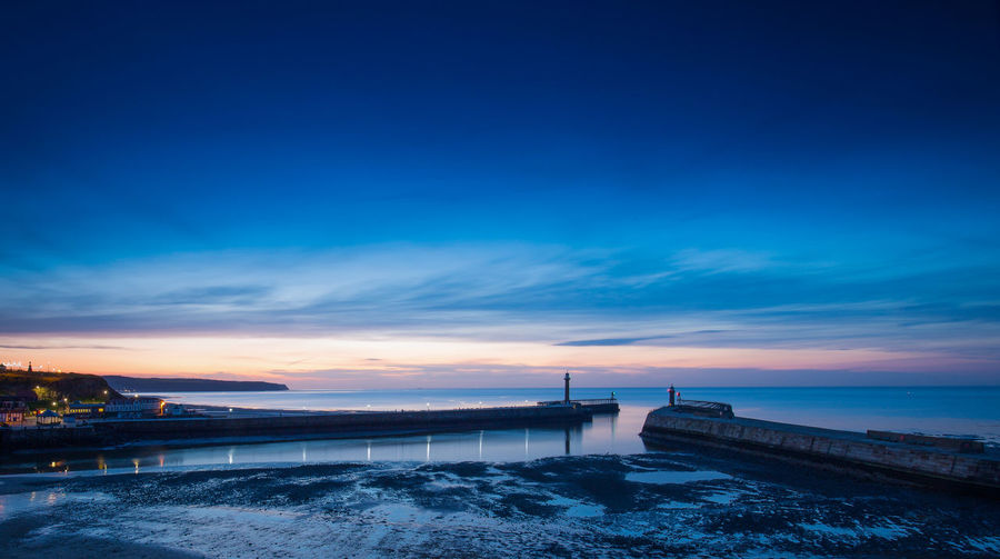 Whitby Harbour at night Sky Water Architecture Built Structure Nature Blue Building Exterior Sunset Cloud - Sky Scenics - Nature No People Connection Beauty In Nature Sea City Waterfront Outdoors Seaside Seaside Town Seaside Beach Sea Whitby Whitby Harbour Whitby North Yorkshire Yorkshire Yorkshire Coast Night Nightphotography Night Photography Seascape Harbour