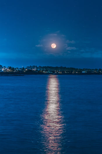 Once In A Blue Moon Sky Water Beauty In Nature Waterfront Scenics - Nature Moon Sea Night Tranquil Scene Tranquility Nature Full Moon Reflection No People Blue Cloud - Sky Moonlight Idyllic Space Outdoors Astronomy