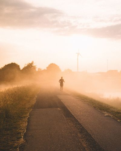Those Early morning runs! | One Person One Man Only Outdoors Rural Scene Men Adventure Landscape Wanderlust Early Morning EyeEm Selects Agriculture Freshness Netherlands EyeEmNewHere Foggy Morning Travel Destinations Rural Tranquil Scene Thick Fog Running Athlete Morning Run Active Beauty In Nature Golden Hour Investing In Quality Of Life