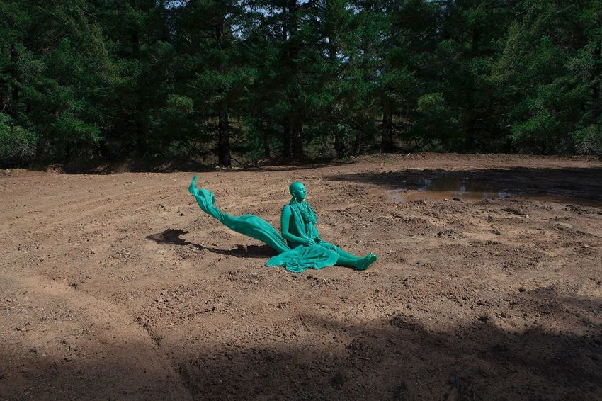 Model: Abominatrix. This series discusses how far we as humans have distanced ourselves from nature, causing us to sometimes feel out of place in the wilderness. Our involvement in manufactured things can make us feel like a foreign object in a landscape. 🏞 Shadow One Person Green Color Tree Sand Outdoors Real People Nature Day People Break The Mold