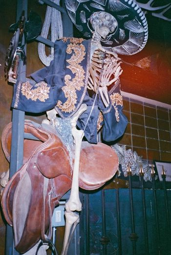 35mm Film Film Photography Analogue Photography Skeleton Cowboy Halloween Cowboy Hat Saddle Western Gunslinger  Spooky Macabre Flash Photography Saloon Bar Nightlife Weird Bizarre Skull Dead