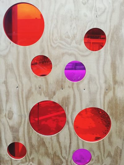 Red circles in a wooden fence Red Multi Colored Red Circles Circles Wooden Fence Red Color See Through