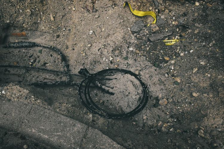 Das Internet ... Urban Perspectives Street Photography Cable Construction Site The Devil's In The Detail High Angle View No People Dirt Day Outdoors Land Vehicle Dirty Road Water Directly Above Mode Of Transportation City Close-up Black Color Street Footpath Sidewalk The Street Photographer - 2019 EyeEm Awards My Best Photo