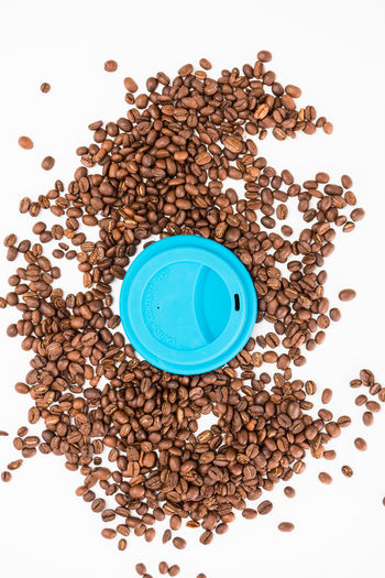 Top View of Silicone Coffee Cup Lids On Coffee Beans on White Background White Background Studio Shot Food And Drink Indoors  Still Life Food Coffee - Drink High Angle View Large Group Of Objects Coffee Directly Above Wellbeing Cup Freshness Drink Roasted Coffee Bean Healthy Eating No People Refreshment Abundance