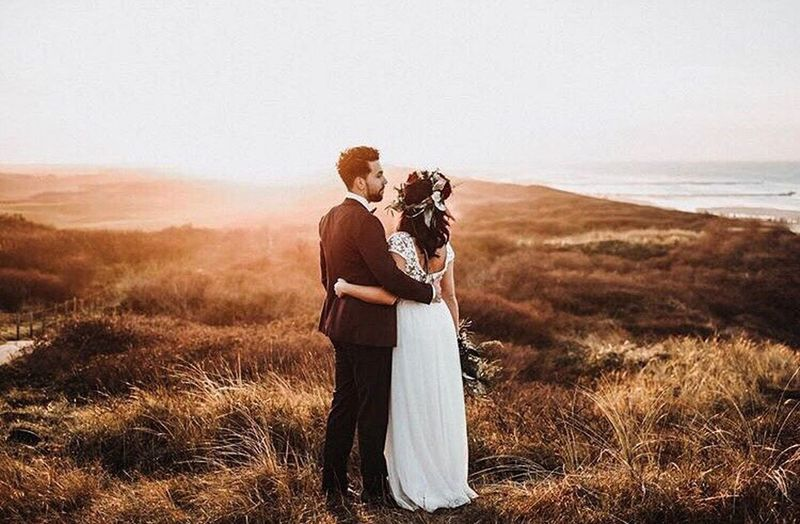 Two People Togetherness Adults Only Adult Love Standing Heterosexual Couple Embracing People Grass Affectionate Bonding Outdoors Full Length Well-dressed Young Adult Young Women Day Happiness Nature