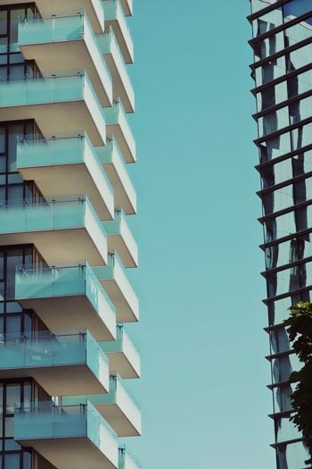 Building Exterior Architecture Built Structure Building No People Sky Low Angle View Outdoors Repetition Window Blue Residential District Nature Apartment City Day Pattern Clear Sky In A Row Balcony The Architect - 2019 EyeEm Awards