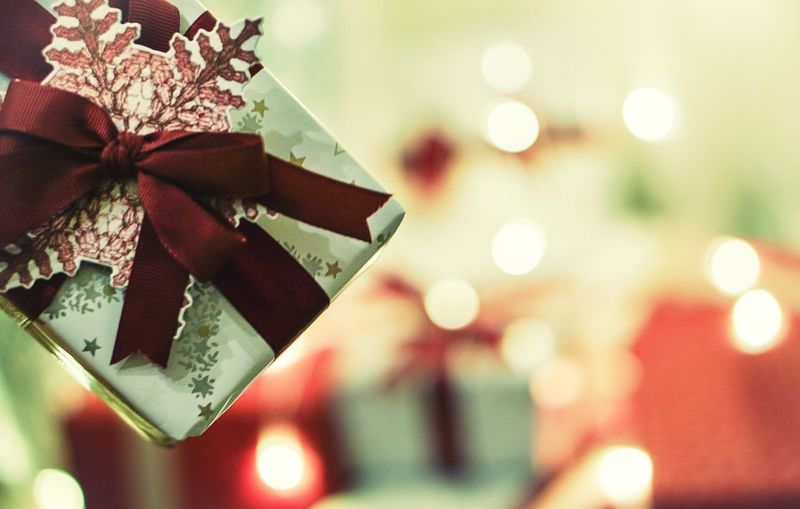 The more you give the more you receive EyeEm Selects Gift Giftgiving Celebration Celebrate Sony Sony A6000 Sonyalpha Christmas Celebration Christmas Decoration Gift Tied Bow Christmas Present Close-up Ribbon - Sewing Item Holiday - Event Indoors  Illuminated Christmas Lights Christmas Ornament
