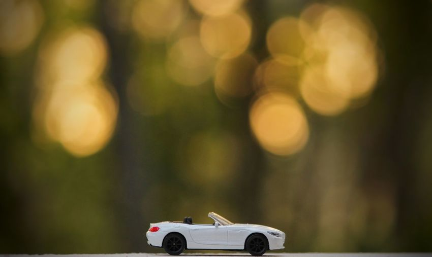 Car and bokeh Bokeh Photography This Is Masculinity Tree Close-up Toy Car Vehicle Lens - Optical Instrument Parking Microscope Slide Microscope Magnification Coin-operated Binoculars Model - Object Binoculars Toy Animal Toy Lens - Eye Optical Instrument Microbiology Bicycle Rack Parking Lot Digital Single-lens Reflex Camera Digital Single-lens Reflex Camera Optometrist Observation Point School Science Project Coin Operated Biologist Hand-held Telescope