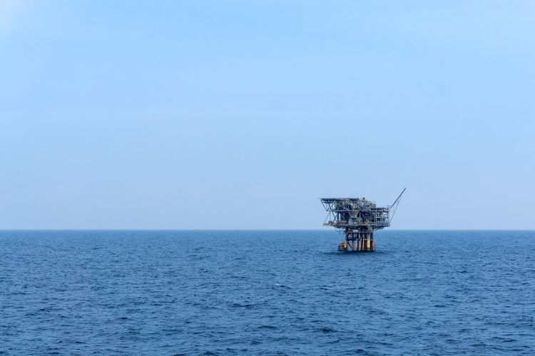 workplace... isolated tripod satellite platform at oil field Industrial Offshore Offshore Life Oil Gas Oil And Gas Industry Petroleun Upstream Drilling Production Exploration Oil Rig Installation Oil Field Blue Sky Work Safety Environmental Sea Drilling Rig Offshore Platform Water Blue Sky Horizon Over Water Seascape Ocean Wave