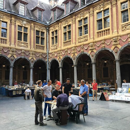 Playing chess in Lille Lille France Courtyard  Chess Tabletop People Together