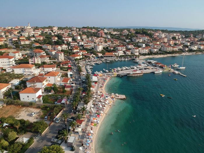 Okrug Gornji marina from above Croatia From Above  Aerial View Panorama City Sea Water Beach Cityscape Aerial View Sand Summer Sky Horizon Over Water Yacht Regatta Dalmatia Region - Croatia Coastline Sailing Ship Rigging Adriatic Sea Sailor Yachting Seascape Marina Boat Deck Sailing Boat Mast Sailboat