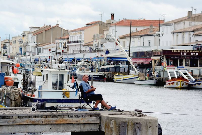 Patient fisherman Kevincaetano Fisherman Harbor City Day Only Men Travel Destinations Outdoors Sea People Water