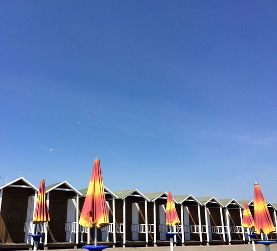 In A Row Ostia Beach Ostia Beach Beachphotography On The Beach Clear Sky Summer Summertime Summer Views Live In The Beach Beach Life Sea Sea And Sky Seaside Houses Colors and patterns Minimalist Architecture