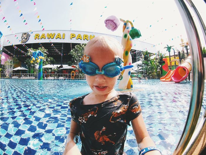 Boys Child Childhood Day Emotion Eyewear Front View Happiness Innocence Leisure Activity Lifestyles Males  Men One Person Outdoors Pool Portrait Real People Smiling Swimming Pool