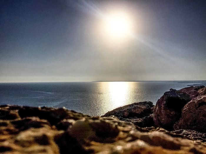 Horizon Over Water Sea Water Sun Beauty In Nature Beach Sky Tranquil Scene Scenics Tranquility Rock - Object Sunbeam Sunlight Idyllic Seascape Majestic Shore Nature Tourism Reflection Summer The Magic Mission