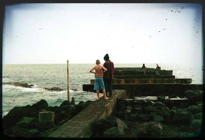 Exploring a Pier on the Southside of the Big Island Hawaii , it was Destroyed Multiple times by Tsunami . Was used mostly by the Sugar Mill Way Back When Back In The Day . My Son and My Best Friend Aloha! Breathing Space