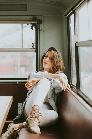 Woman sitting in bus