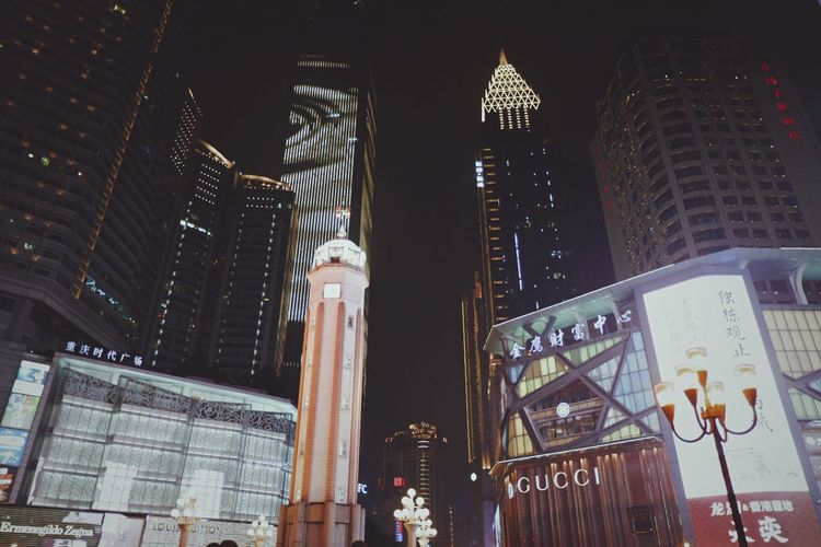 Low angle view of illuminated buildings at night