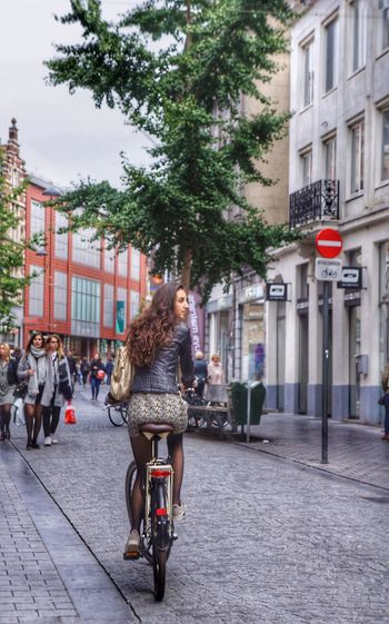 Don't look back Bicycle Outdoors People Mode Of Transport City Tree Building Exterior Belgium Traveling Travelphotography Traveltheworld Travelling Travel Photography Europe Trip Europe Peopleandplaces People Walking  Bikecycle Vintage Bikecycle City Street Street City Travel Destinations Architecture Sky Finding New Frontiers