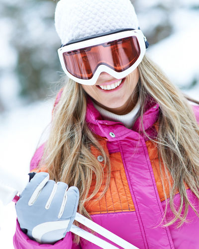 portrait of woman wearing hat Active Blond Hair Carry Clothing Cross-Country Skiing Day Fashion Focus On Foreground Forest Hair Hairstyle Happiness Happy Hat Headshot Holiday Leisure Leisure Activity Lifestyle Lifestyles Nature On The Way One Person Outdoors Outside People Pink Color Portrait Real People Scarf Ski Ski Goggles Ski Holiday Ski Poles Ski Trip Skier Skiing Smile Smiling Snow Sport Warm Clothing Winter Winter Holiday Winter Sports Woman Women