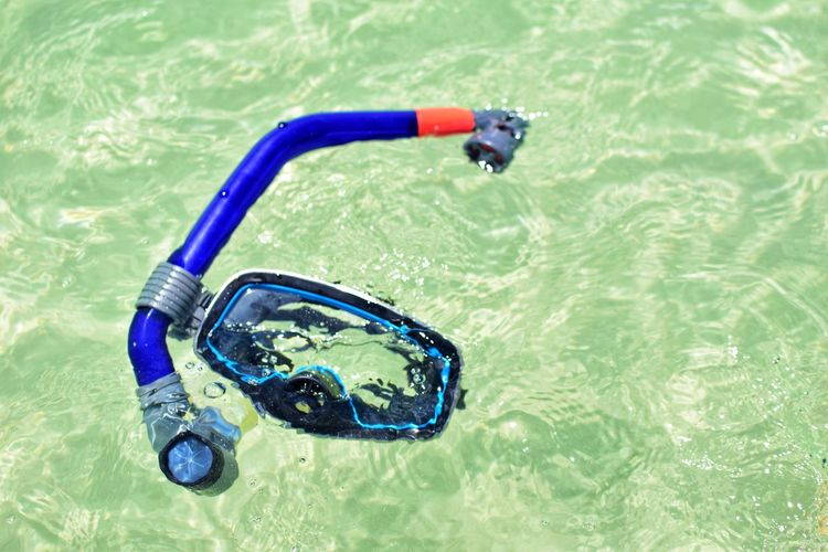 Close up of snorkels sea is floating in a blue and Summer vacation swimming concept. Holiday Scuba Diving Vacations Blue Close-up Eyewear Floating Floating On Water High Angle View Nature No People Outdoors Pool Rippled Scuba Mask Sea Snorkel Summer Sunlight Swimming Swimming Goggles Swimming Pool Turquoise Colored Water Waterfront