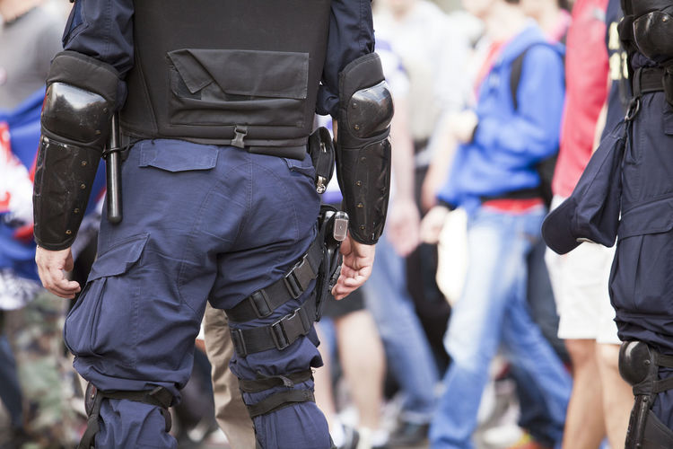 Police officer on duty. Counter-terrorism. State of emergency. Adult Day People Weapon