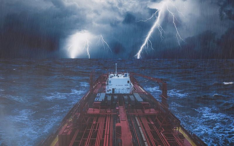 Ship on sea against storm clouds