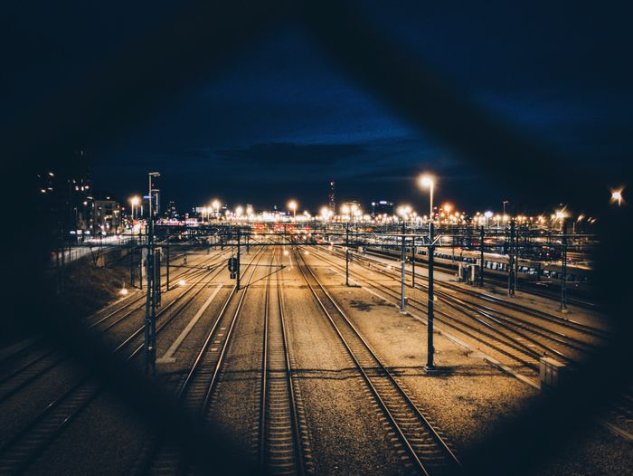 Railroad Tracks Against Sky At Night