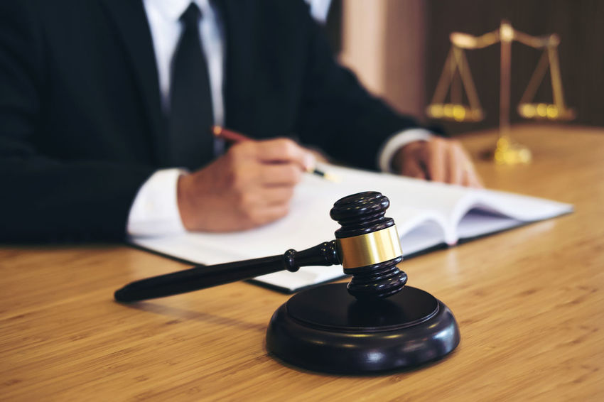 Lawyer Adult Balance Barrister Close-up Consultant Counselor Courthouse Fairness Focus On Foreground Front View Gavel Hand Holding Human Body Part Human Hand Indoors  Inheritance Legal Legislation Men Sitting Verdict Wood - Material Writing