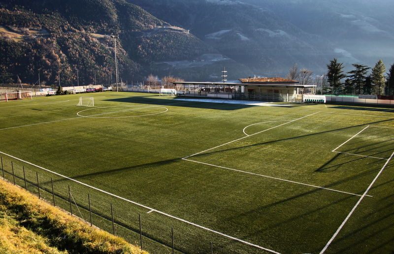 Day December 2015 Elevated View Empty Football In The Mountains Outdoors Parcines,sudtirol Soccer Sport Stadium Sunset Light