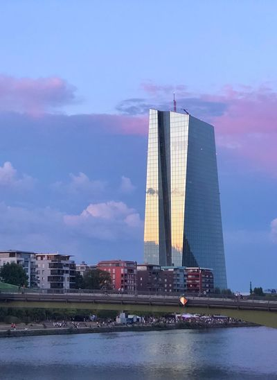 View of modern building against cloudy sky
