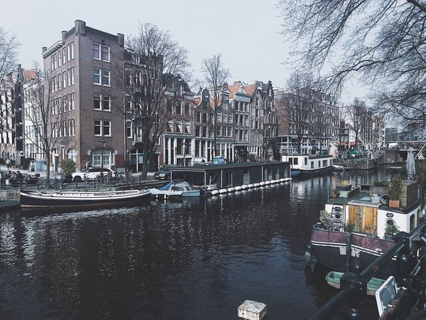 Travel Photography Canal Building Exterior Architecture Nautical Vessel Built Structure Transportation Mode Of Transport City Water Outdoors Tree Moored Residential Building Day No People Sky Tourboat Amsterdamcity Amsterdam Travel IPhoneography IPhone Photography Photographer Holland