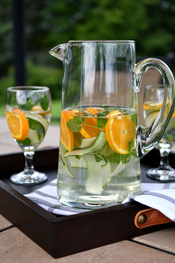 Infused spa water - cucumber slices, oranges and orange mint in water. Cucumbers Detox Drink More Water Hydration SPA Water Serving Drinks Cucumber Water Dehydration Detoxwater Drink Drinking Glass Drinks On A Tray Food And Drink Fruit In Water Health Spa Healthy Healthy Drinks Healthy Eating Healthy Lifestyle Infused Water Mint Oranges Refreshment Spa Water