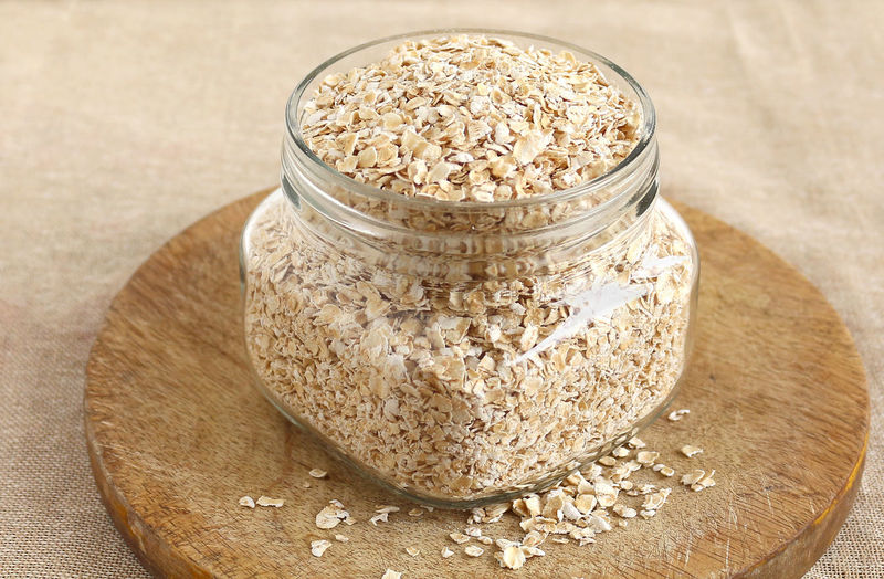 Oats in a Bottle on a Wooden Table Blood Cereal Cholesterol Diet Dietary Fibers... Dieting Fiber Food Front View Glucose Glycemic Healthy Heart Health Index Insoluble Nutrition Oats Raw Sugar Vegetarian Weight Loss Foods Whole Grain Zero