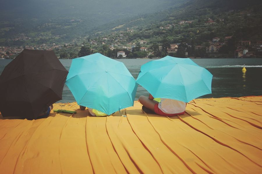 Walking on the Floating piers | Golden Moments  Relaxing Point Of View Tailored To You Umbrellas Sunshine Feel The Journey Christo And The Floating Piers Close-up The Essence Of Summer Getting Inspired Edge Of Imagination The Floating Piers Still Life Fine Art People The OO Mission 43 Golden Moments Showcase July Original Experiences Lake The Mix Up Lago D'Iseo EyeEm Italy |