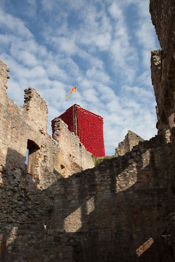 Art Installation Cloudy Sky Red Balloon Rötteln Architecture Building Built Structure Castle Ruin Flag Fort History Knight  Light And Shadow Low Angle View Old Red Sky Stone Wall Sunlight The Past Tower Wall - Building Feature