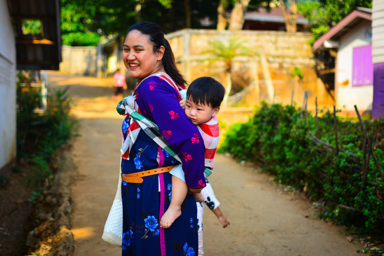 Chiang Rai, Thailand Child Childhood Family Females Real People Women Two People Emotion Focus On Foreground Togetherness Lifestyles Casual Clothing Mother Boys Males  Parent Happiness Smiling Innocence Outdoors Hairstyle Positive Emotion