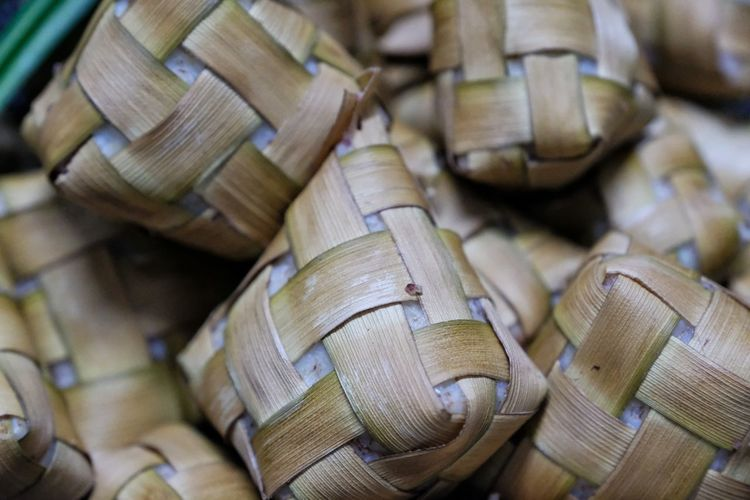 KETUPAT NASI / RICE DUMPLING IS A LOCAL DELCACY DURING THE FESTIVE SEASON. KETUPATS, A NATURAL RICE CASING MADE FROM YOUNG COCONUT LEAVES FOR COOKING RICE Stack Sack Full Frame Textured  Backgrounds Close-up